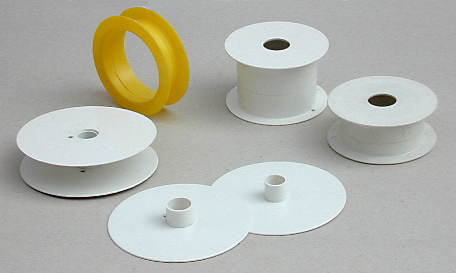 Impact polystyrene molded in two pieces for bias ribbon and the like