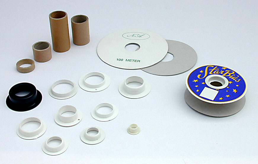 Flange and tube made of cardboard, caps made of shock absorbent polystyrene, for material that requires spiral upon spiral winding.