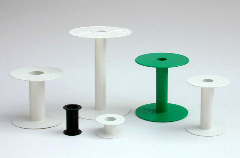 Shock absorbent polystyrene, molded in one piece, suitable for all ribbons that require (zig zag) winding.
